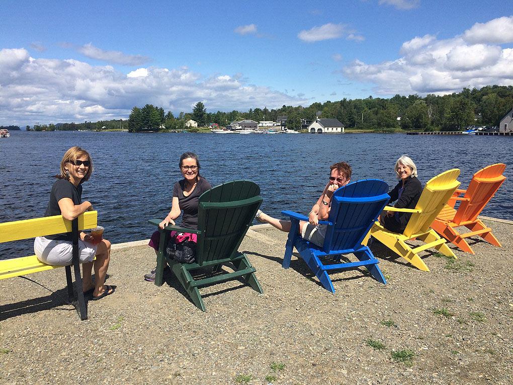 Summer-shoreline-women-adirondack-chairs